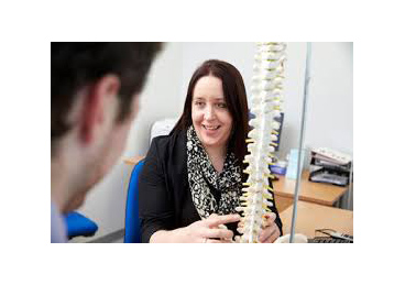 woman holding spine model