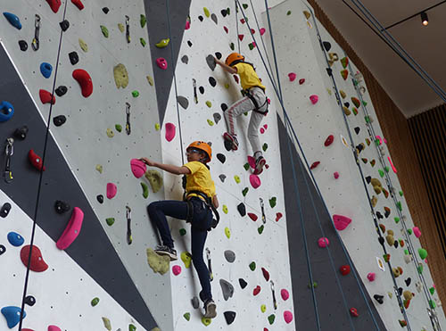 Two juniors on the climbing wall