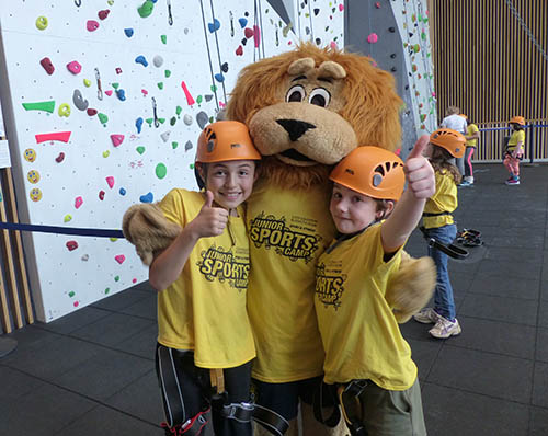 Rory the lion at the junior sports camp with two juniors