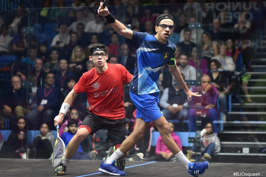 Two squash players competing in the glass showcourt at the 2018 British Junior Open