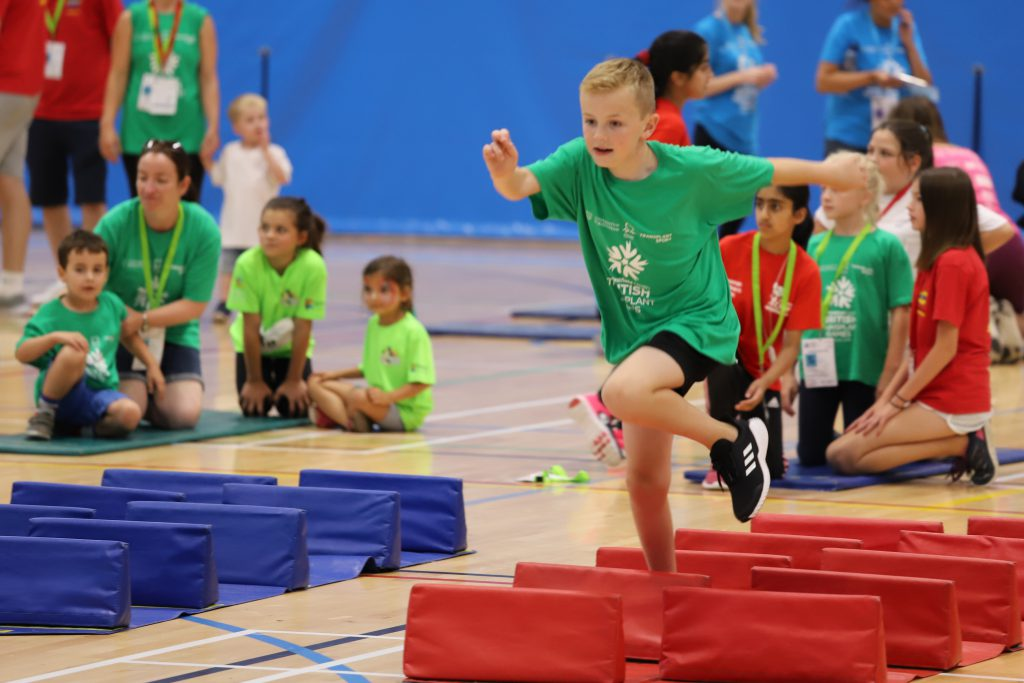 Child running in the sports hall during British Transplant Games