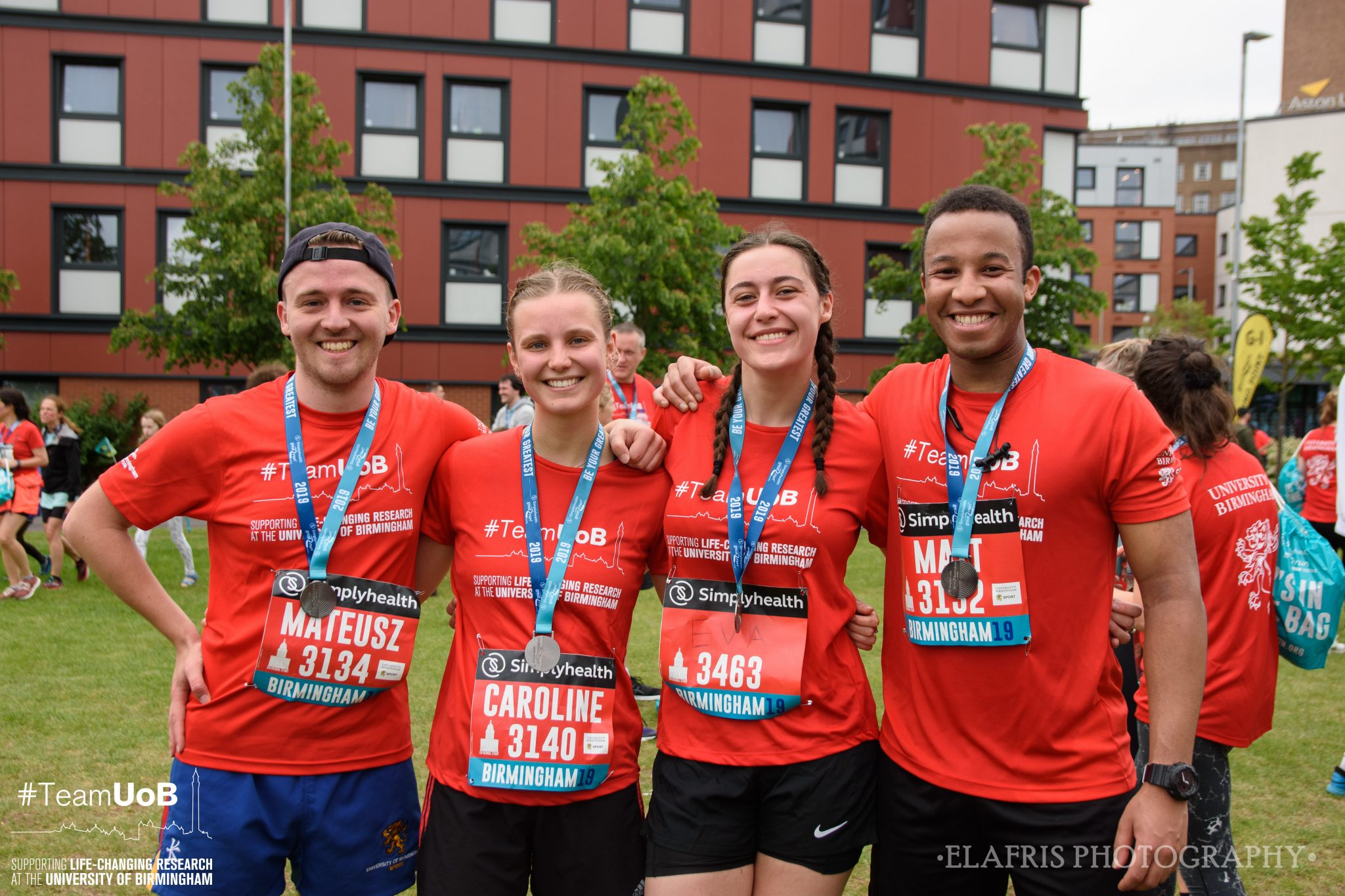 Four members of Team UoB with medals after Great Birmingham 10k